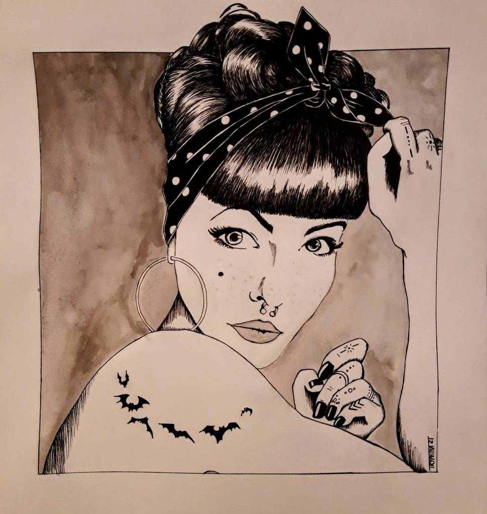 portrait of a rockabilly styled woman with tattoos on her shoulder and on her fingers